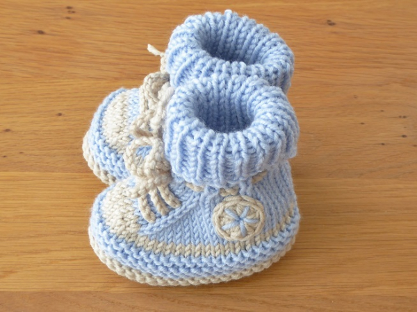 7cdac59fe Handknitted booties pale blue and beige